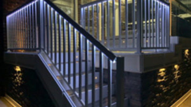 a building with a metal railing