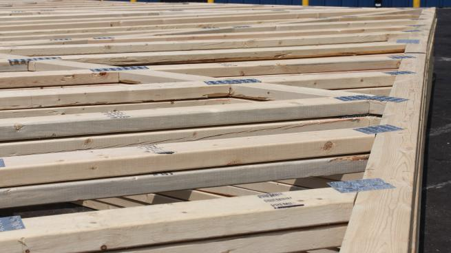 a row of wooden benches sitting on top of a bench