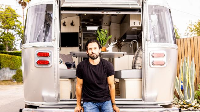 Milo Ventimiglia standing in front of a truck