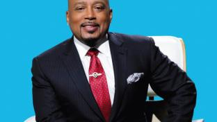 Daymond John wearing a suit and tie