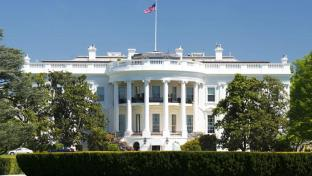 a large building in the background with White House in the background